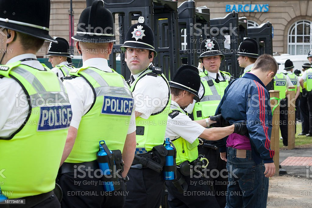 Police search a man at the English Defence League rally stock photo