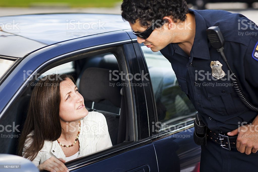 Police speaking with woman driver stock photo