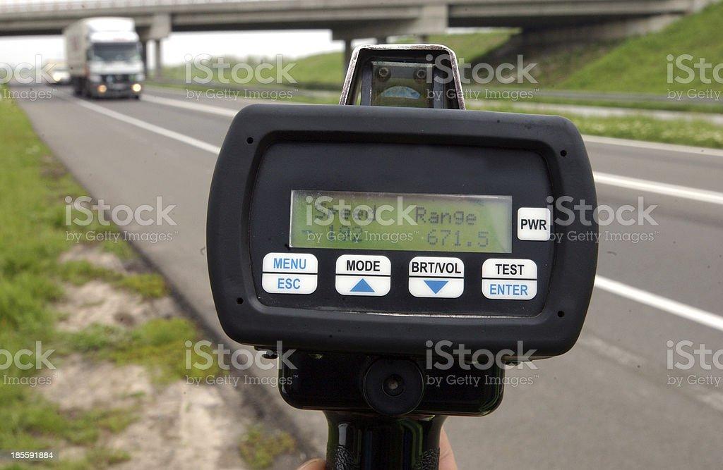 Police speed gun monitoring traffic  stock photo