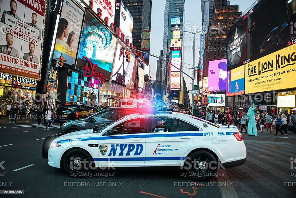 NYPD police squad car goes to emergency call with alarm stock photo