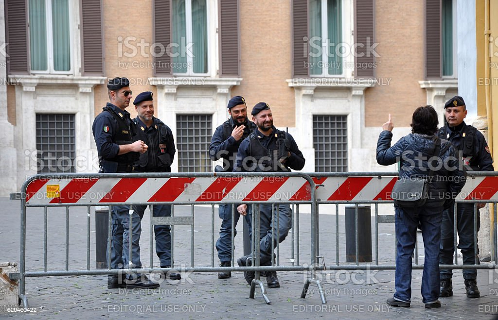 Police standing in front of the Italian Chamber stock photo