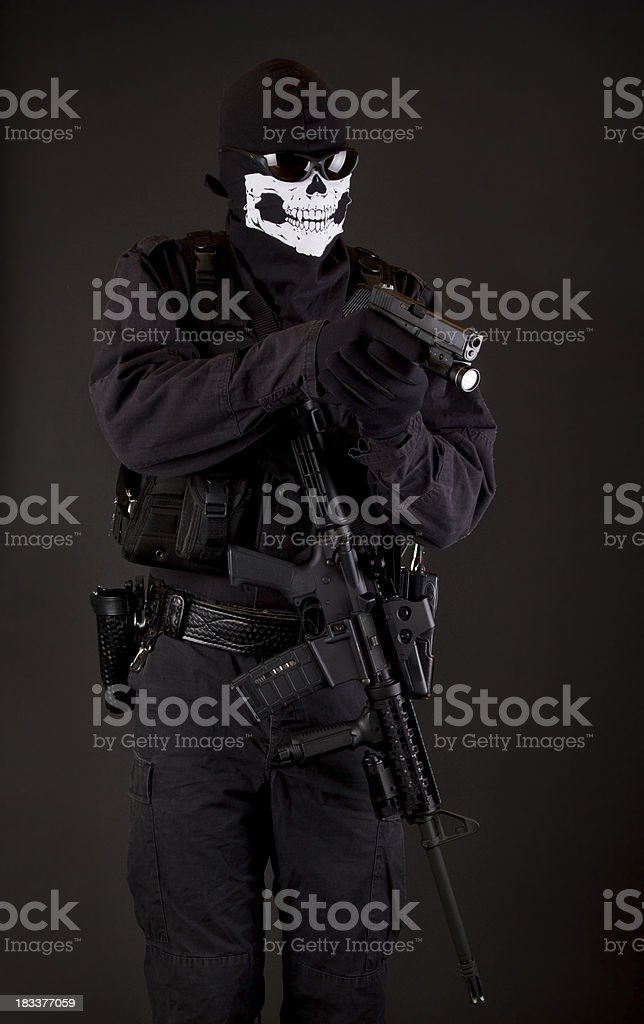 Police SWAT with handgun and Ghost Skeleton Mask stock photo