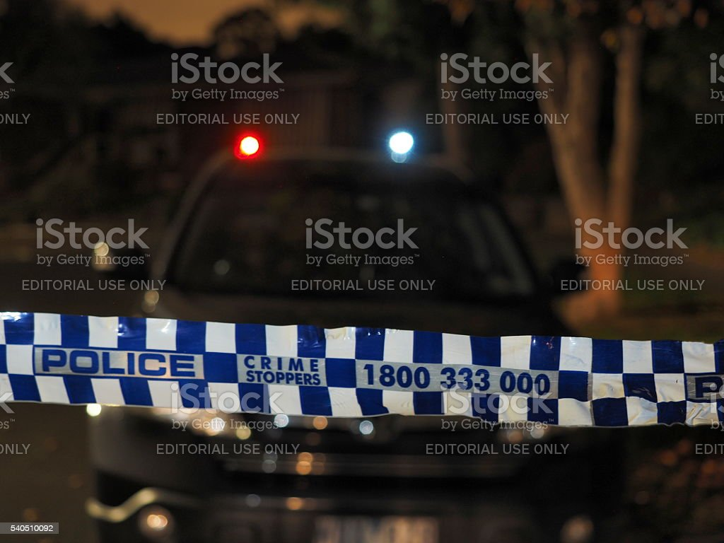 Police tape cordoning off a car at night stock photo
