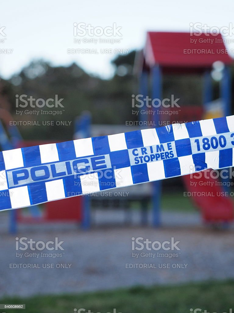 Police tape cordoning off an colorful playground stock photo