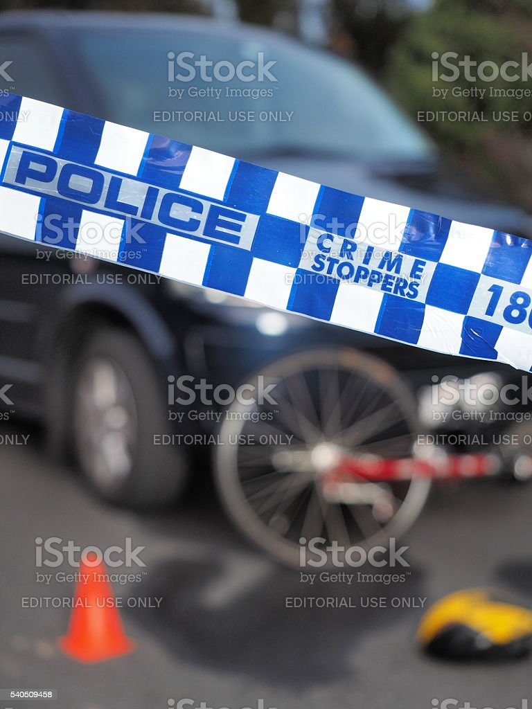 Police tape used to cordon bicyle and car accident stock photo