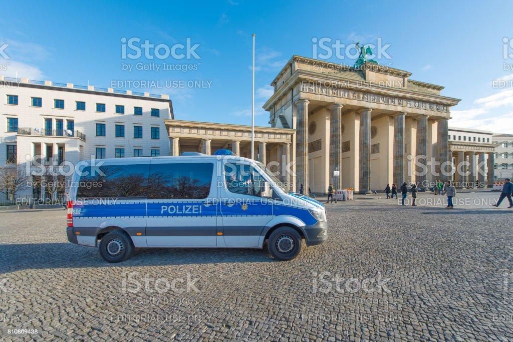 Police van in front of the Brandenburg Gate stock photo
