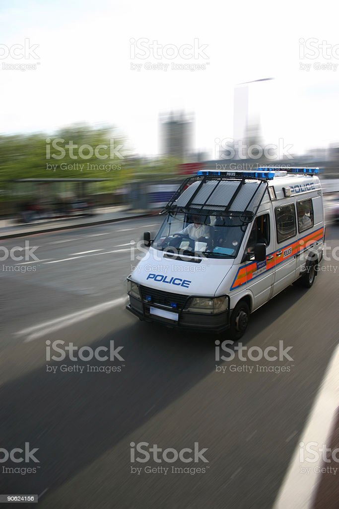 Police van traveling at speed along the highway stock photo