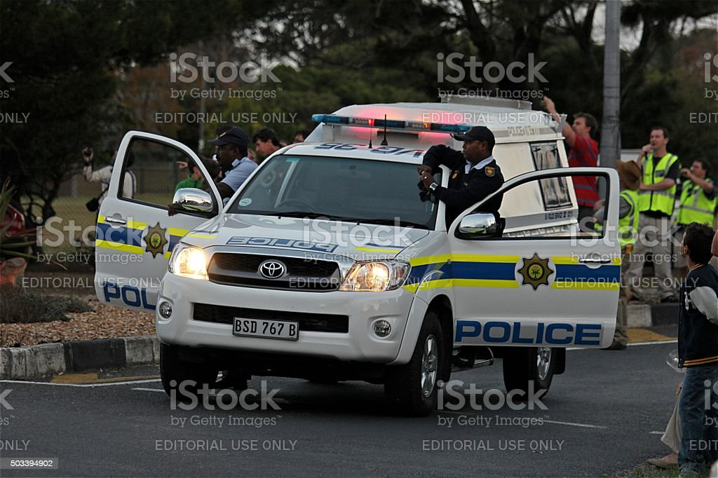 S.A. Police vehicle with doors open and two officers stock photo