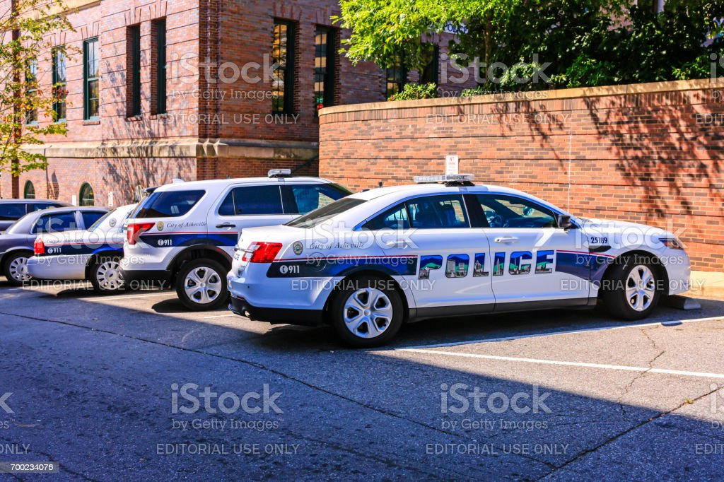 Police vehicles outside the Police Department building in Asheville, NC, USA stock photo