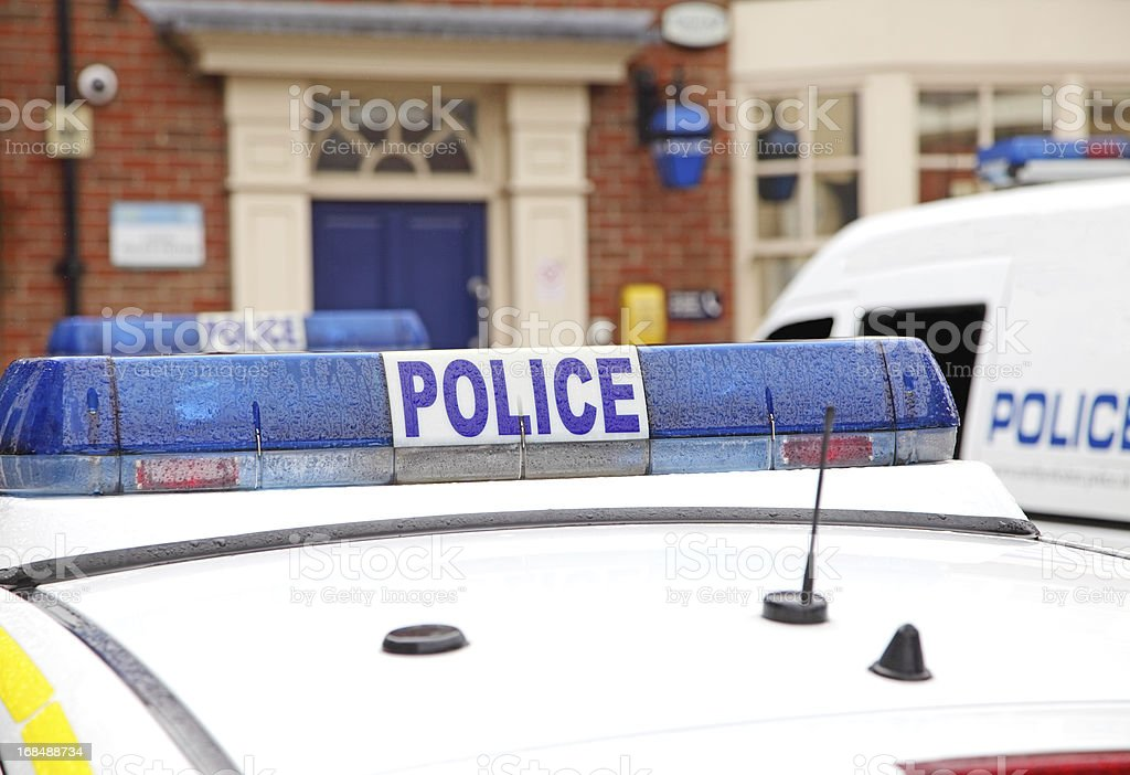 police vehicles parked outside a  station royalty-free stock photo