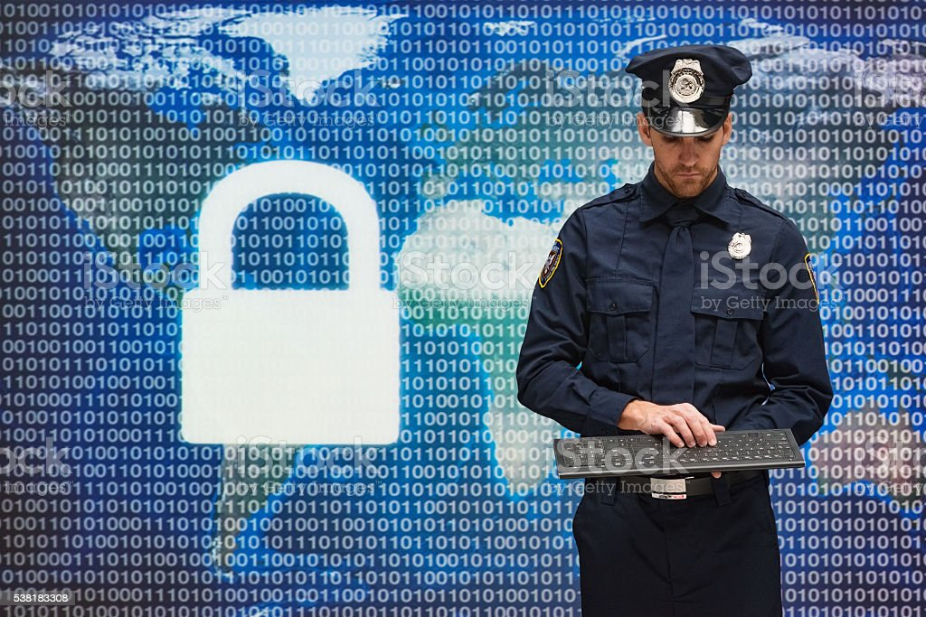 Police working on keyboard stock photo