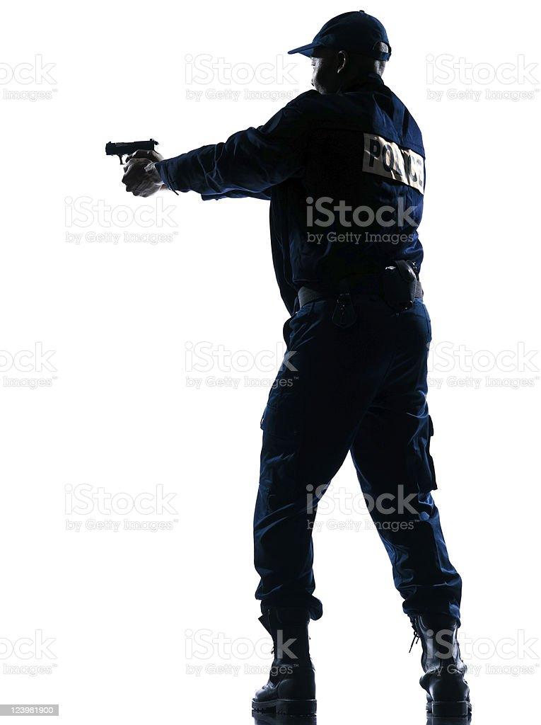 Policeman aiming handgun stock photo