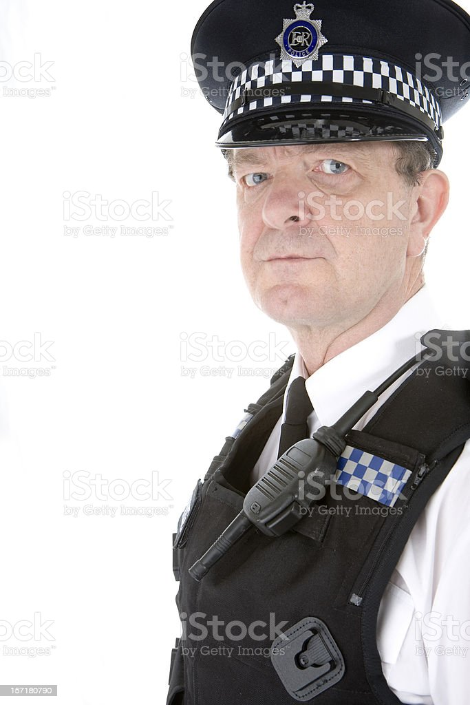 UK policeman: an authoratative glance from a uniformed British cop stock photo