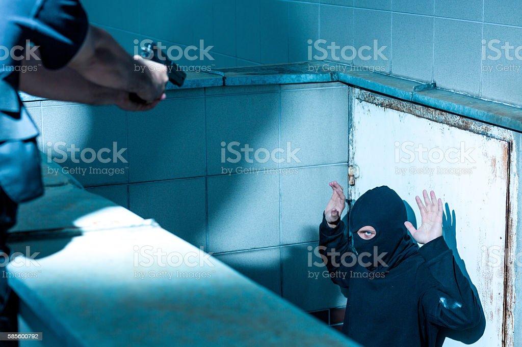Policeman and fugitive man stock photo