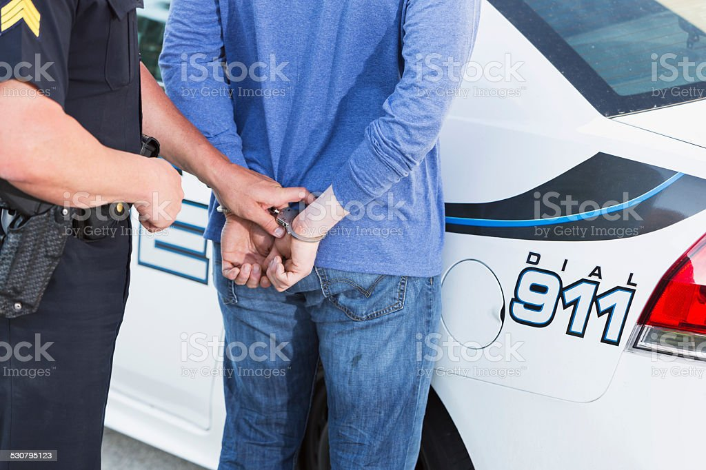 Policeman arresting a criminal stock photo