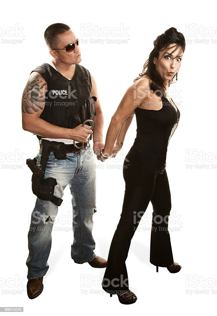 Policeman arresting pretty woman royalty-free stock photo