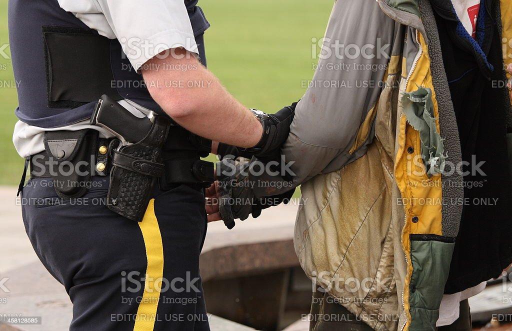 Policeman Controlling Poor Man stock photo