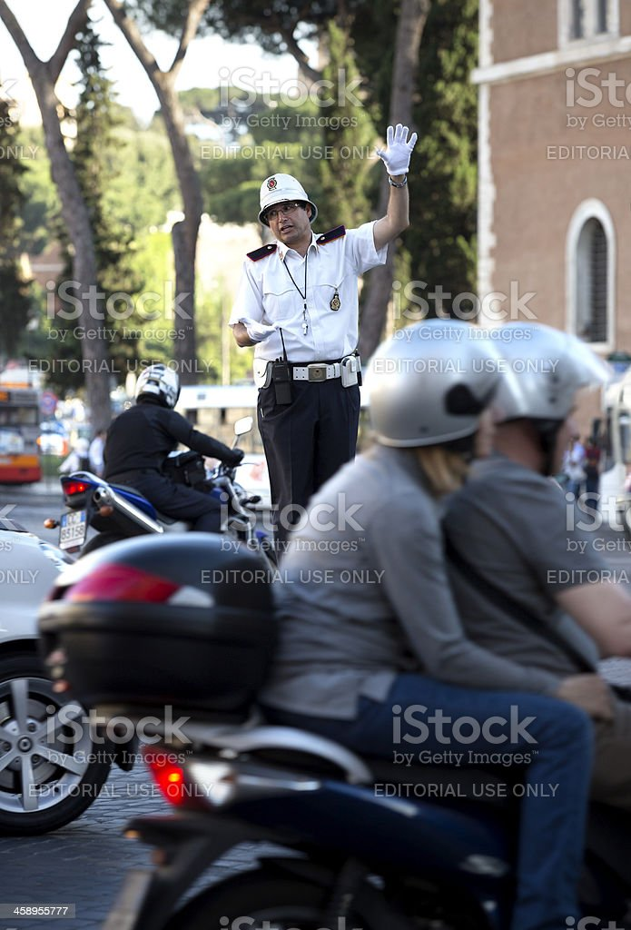 Policeman directing the traffic in Piazza Venezia, Rome Italy royalty-free stock photo