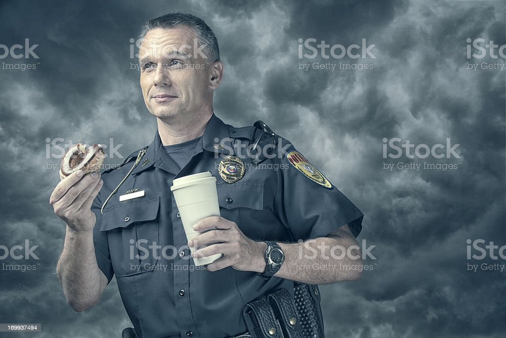 Policeman excited about his donut and coffee break royalty-free stock photo