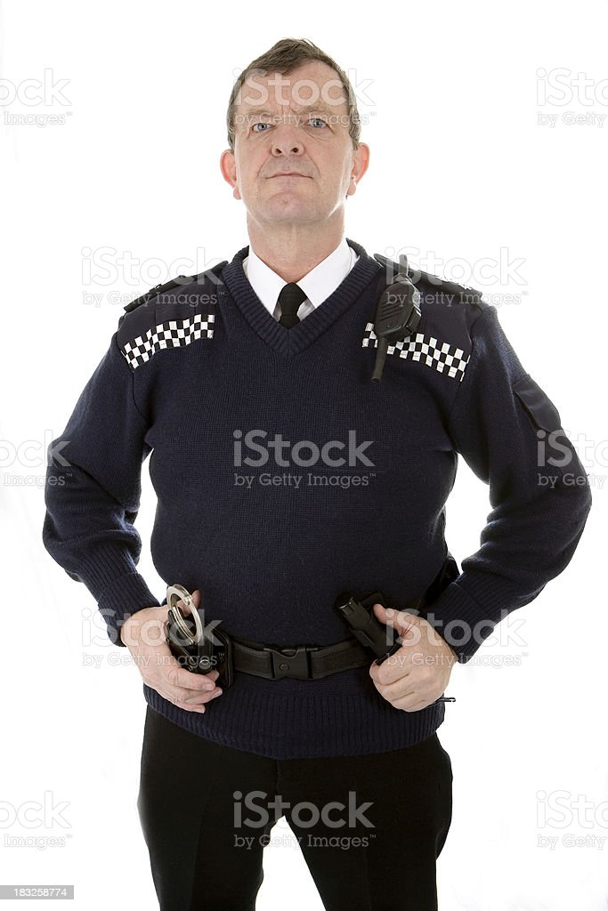 UK policeman: eye contact from an authoratative uniformed police officer stock photo