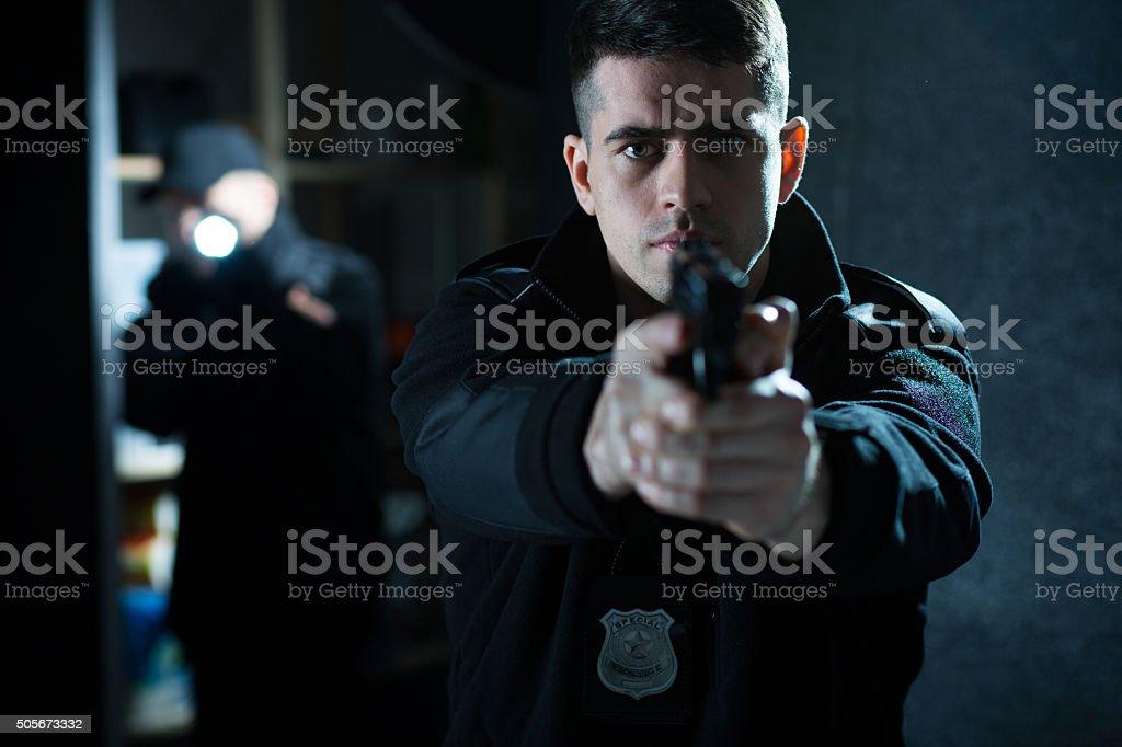 Policeman holding a handgun stock photo