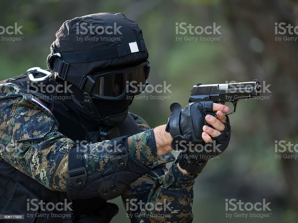 Policeman in action stock photo