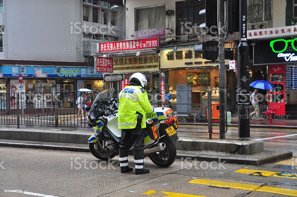 Policeman is doing his job on the street stock photo