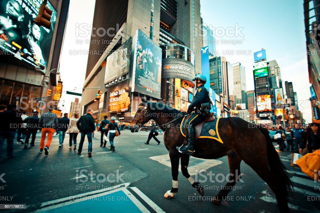 Policeman on a horse crossing Times Square, New York stock photo