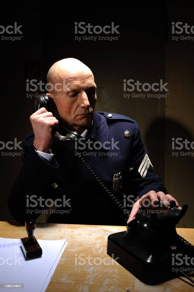 Policeman on the phone stock photo