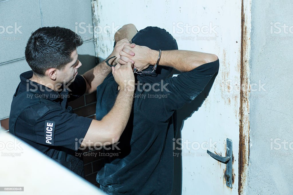 Policeman overpowering kidnapper stock photo