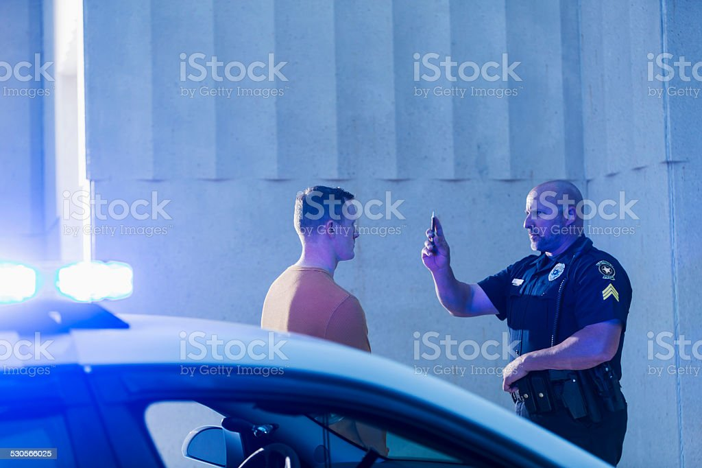 Policeman performing sobriety test on driver stock photo