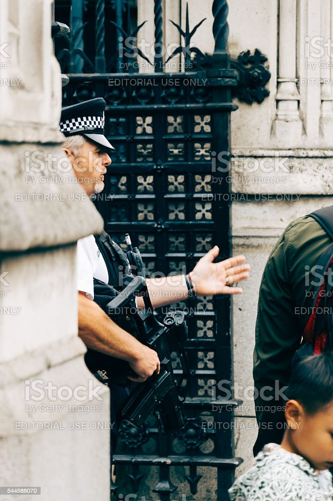 Policeman protecting 10 Downing Street in London stock photo
