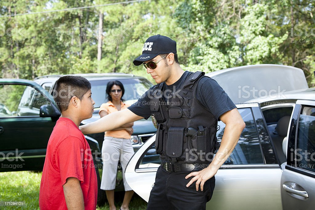 Policeman questioning witnesses during crime investigation stock photo