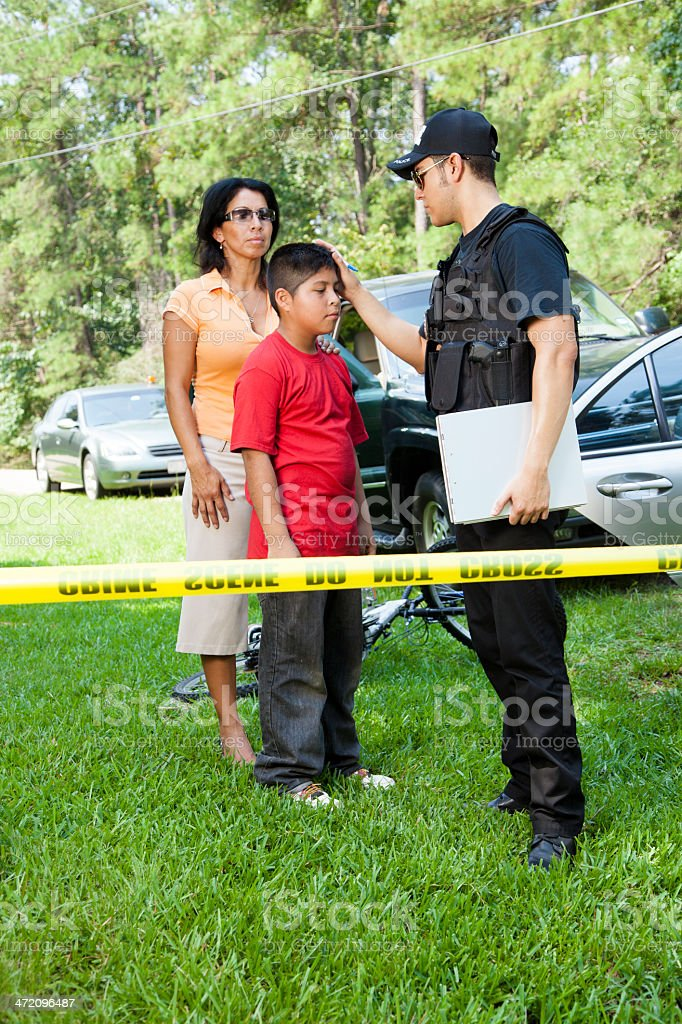 Policeman questioning witnesses during crime investigation. stock photo