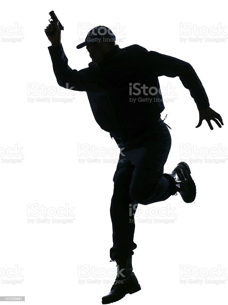 Policeman running with a handgun royalty-free stock photo