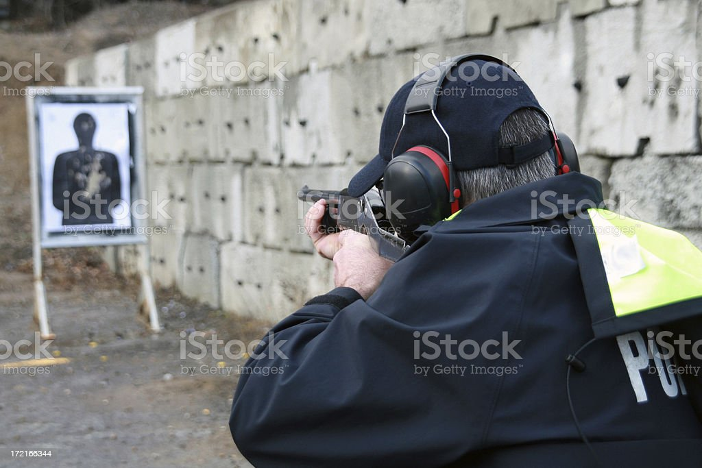 Policeman Shooting Shotgun on Silhouette Target at Practice Field royalty-free stock photo