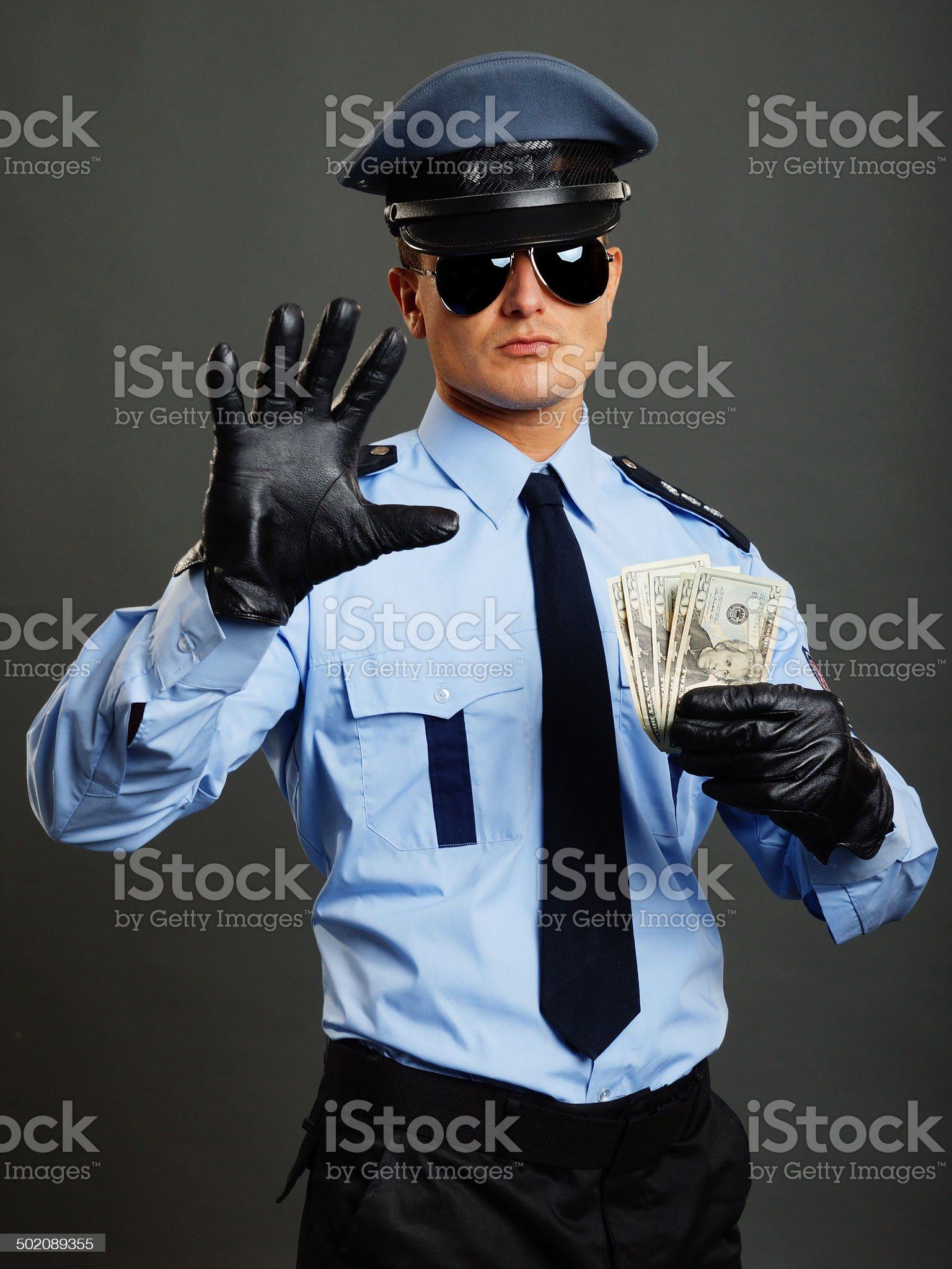 Policeman shows stop royalty-free stock photo