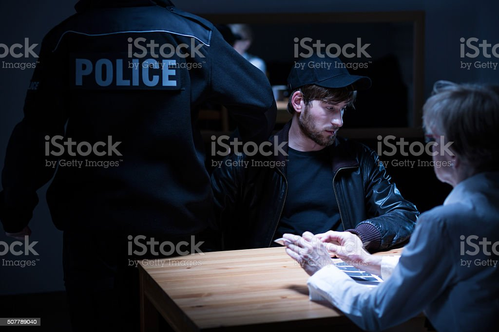 Policeman, suspect and female agent stock photo
