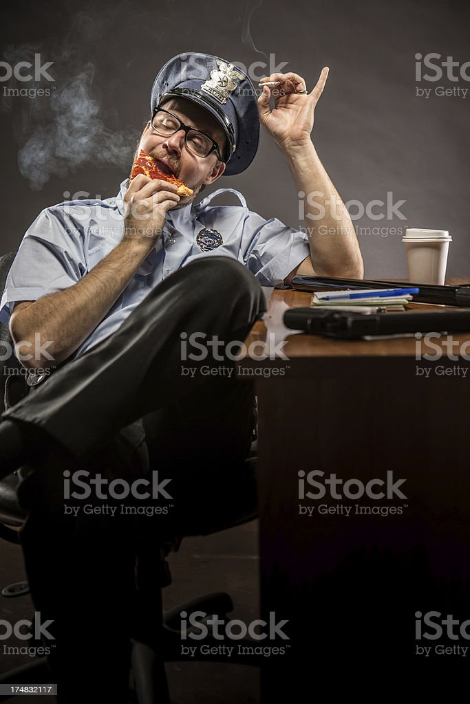 Policeman taking a break with Pizza Smoke and Coffee royalty-free stock photo