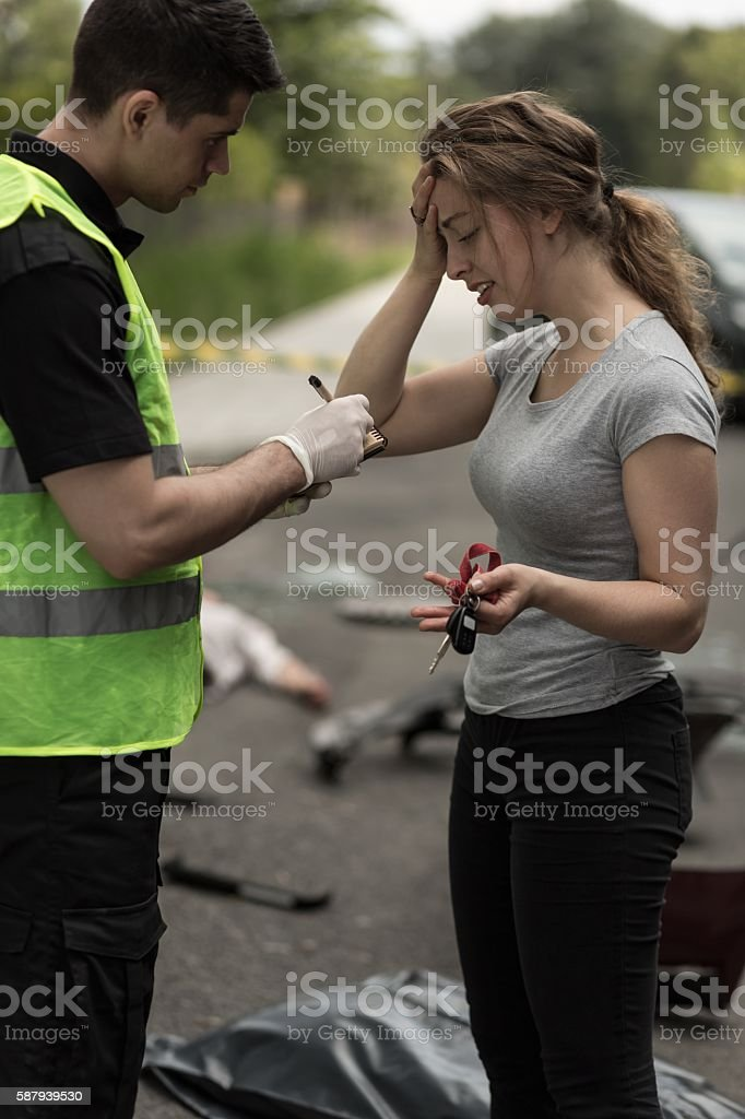 Policeman taking statement stock photo