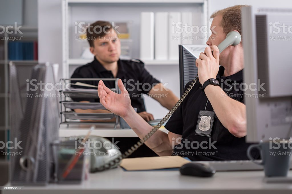 Policeman talking on the phone stock photo