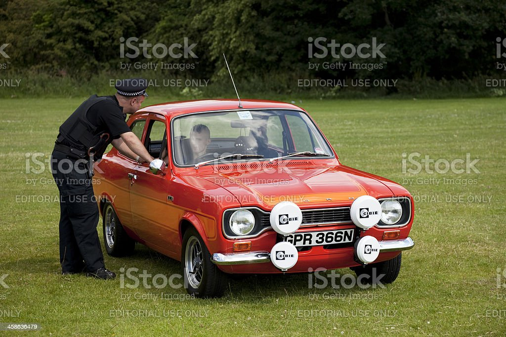 Policeman talks to young car driver stock photo