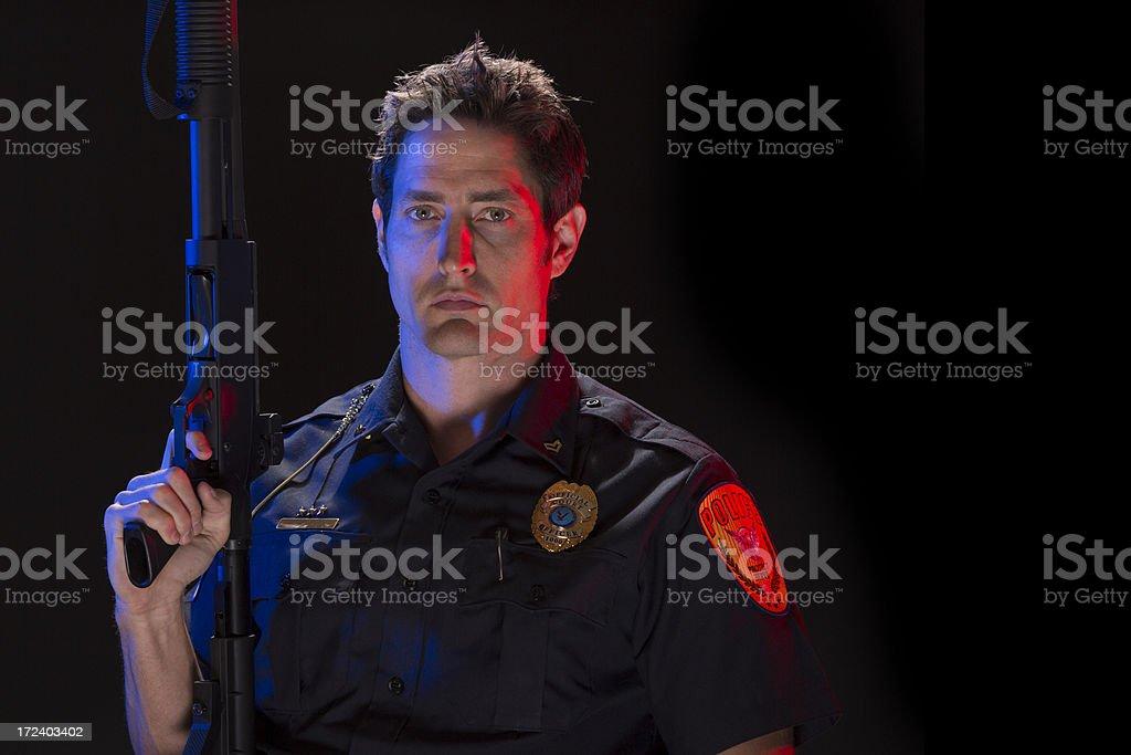 Policeman with a tactical shotgun royalty-free stock photo