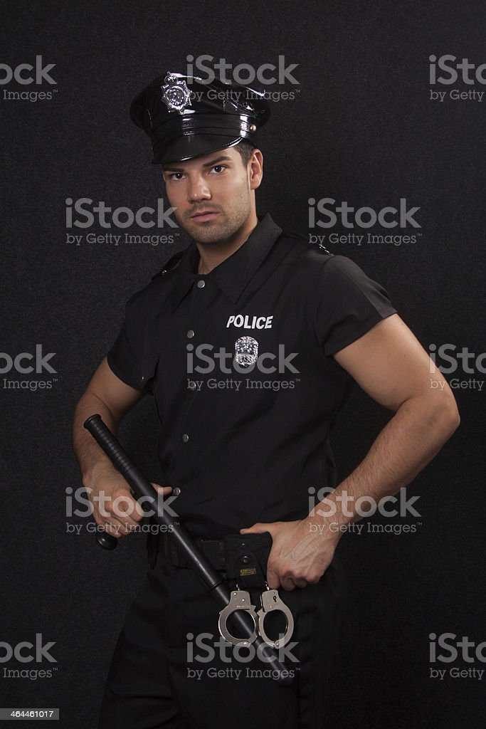 Policeman with blackjack and handcuff stock photo