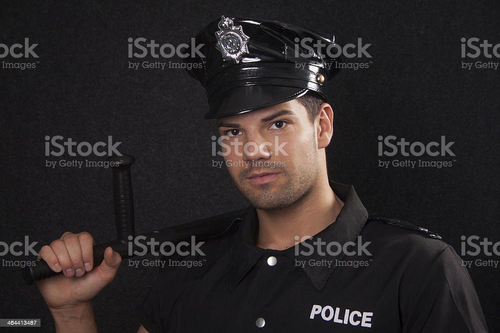 Policeman with blackjack stock photo