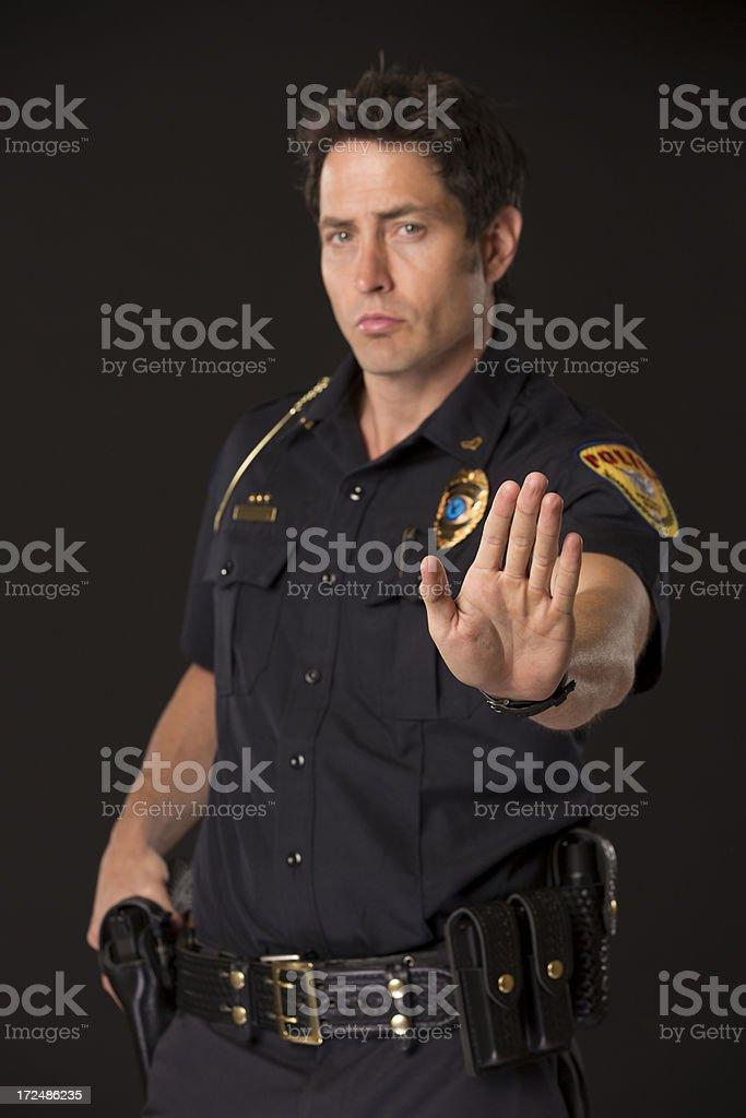 Policeman with Halt Hand Sign stock photo