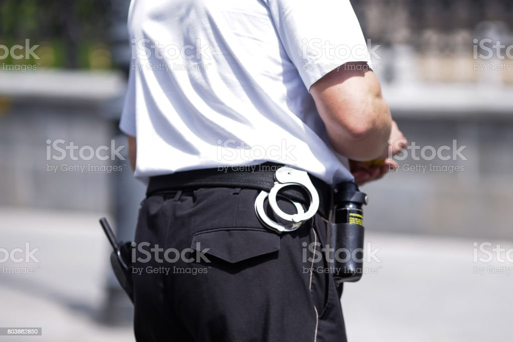 Policeman with handcuffs stock photo