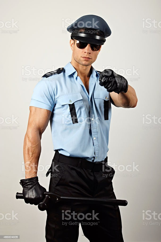 Policeman with nightstick stock photo