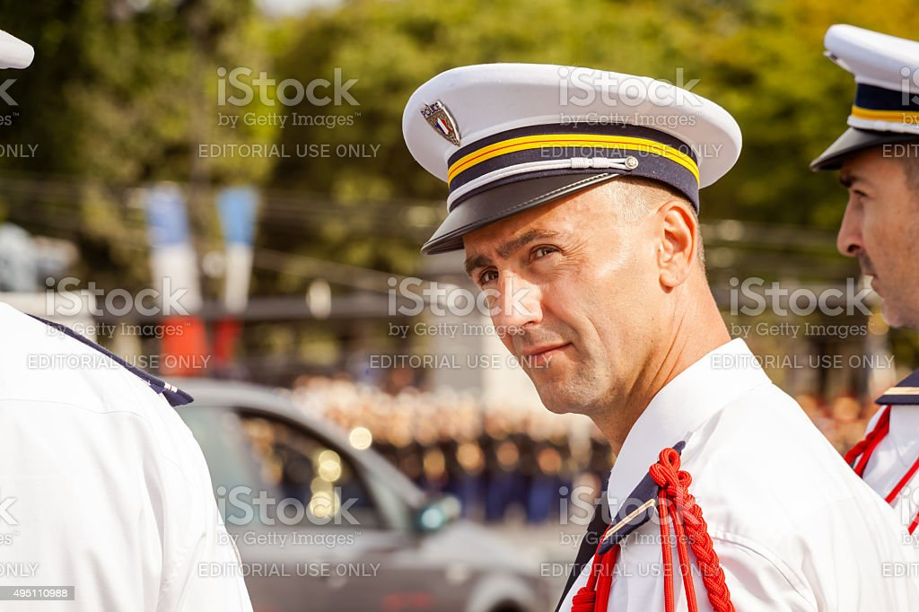 Policeman with red cord at Bastille Day event stock photo