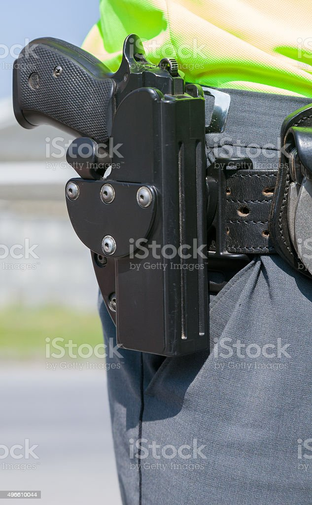 Policeman with the gun stock photo
